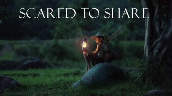 Boy with lantern and words Scared To Share